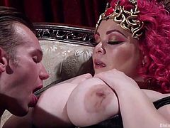 Slutty Mona persuades a horny guy into sucking nipples and eating pussy. All that the pink-haired bitch has to do, is spread her legs widely, while comfortable sitting on the couch. Get prepared for a real lesson from a crazy woman, who knows exactly how to get a guy at her feet. Enjoy the kinky details!