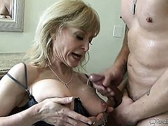 A cougar gets cumshot on her tits