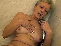 Old wrinkled short haired blondie Jitka masturbates mature cunt in shower