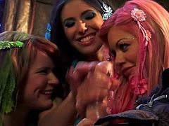 Casey Calvert, Claire Robbins and Riley Steele are naughty ladies with flowers in their color hair. They bare their boobs and then get down on their knees for cock sucking. They give headjob all together.