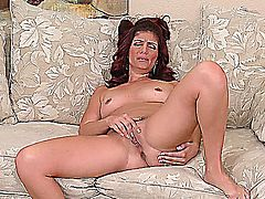MILF Alicia Silver undresses and masturbates