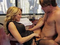 Beautiful MILF blonde Jessica Drake dressed in black is cock hungry. She gives nice blowjob to lucky man and then gets her hole penetrated. Watch Brad Armstrong and Jessica Drake have office sex.
