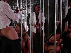 Asa Akira and Jessica Drake sucking cocks behind the bars