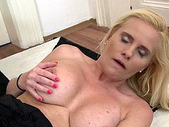 Do you like to see bitches masturbating? Dare to click and enjoy the view of Paulina's naughty cunt getting aroused. The blonde mature lady has revealed her amazing big tits in front of the camera and keeps playing with a pink dildo, which she enjoys to suck and stuff in her pussy, while laying on the floor.