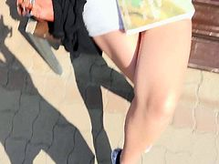 Cute chick Ani Blackfox in black tank top and short white skirt flashes her panties and boobs on a bench in the park and in some other places. Shes a playful girl who loves flashing.