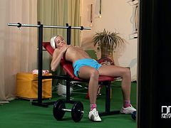 Topless blond cutie doing exercises at the gym