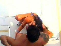 Charming long haired brunette sexpot provides dude with BJ on the yacht