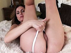 With gigantic hooters and hairless snatch has fire in her eyes as she fucks herself with toy
