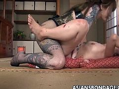 Rough Asian mistress plows her sweet slave