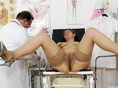 This beauty with natural tits heads into the doctor's office for a check up. He is the best gyno around and today, he is going to see what's going on inside of her. She spread her legs for him and he spreads her pussy wide, before inserting his fingers and a rod.
