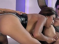 Jessica Jaymes, Kina Kai and Nikita Von James get on the bed together to have a very sexy lesbian threesome. They use toys to help each other get off. There is also pussy licking
