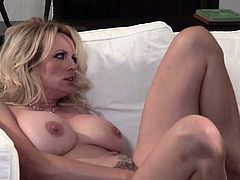Blond-haired sexy MILF Stormy Daniels with big breasts shows her assets to hot dude before he finds his beefy cock in her hot mouth. She takes it up her wet trimmed bush after cock sucking.