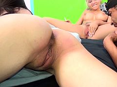 A pair of sexy girls take turns cumming all over this guy's cock