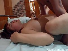 Passionate Asian dissolves in pleasure following a rough missionary pounding