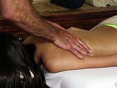 Tanned a bit shy slim brunette gets her nice body massaged
