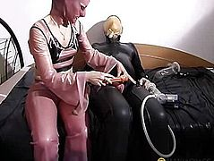 The woman puts on his penis pump