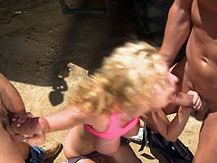Blonde Jessie Rogers with big bottom and huge fake boobs gets double teamed in the sun. Two horny dudes drill her mouth and asshole like theres no tomorrow. Jessie Rogers is a natural born anal slut!