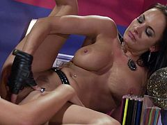Brunette Alektra Blue and blonde Brandy Blair are sexy lesbians with big hooters. They take off their tiny panties but leave their black leather boots on in steamy lesbian action.