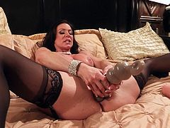 Before Kendra Lust can get a hold of the real deal, she is going to play with some huge sex toys. She dont mind though, since she will be stuffing her horny fanny either way