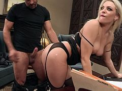 A young blonde in lingerie and black stockings is having some great office sex. She makes that long ding dong really stiff and then he fucks her up real fucking nice