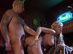 Busty blonde bombshell Brandy Blair shows her assets and spreads her legs wide open by the fire. She gets ehr beautifully shaved pussy licked and fucked by horny inked up guy.