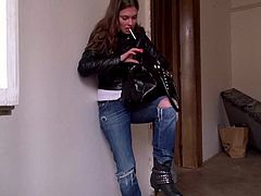 Leggy chick Irina Irina in tight fit blue jeans gets picked off the street to do dirty things for the camera. She strips down to her lovely black panties after smoking a cigarette.
