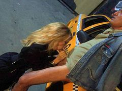 Attractive woman Jessica Drake with long blond hair gives blow job in the dark of the night beside a taxi. Lucky man gets his stiff dick polished with her soft warm lips.