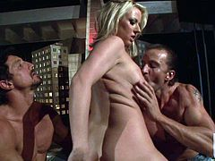 Busty MILF Carolyn Reese strips down to her red thong and plays with her big hooters in front of two hot guys before they bang her together. Experienced slut handles two fat dicks like a pro.