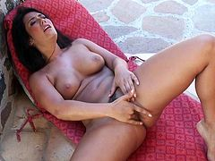 Hot bodied babe Eva Lovia with long black hair strips nude and plays with herself in the garden. She squeezes her lovely boobs, flaunts her butt and rubs her pretty pussy in the shadow.