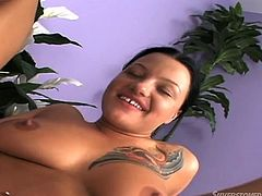 While this hot brunette is totally engaged in a deep throat blowjob, another cock gets stuffed in her appetizing ass... Double penetration seems to incite the lovely naked tattooed bitch, as she keeps smiling charmingly to her partners and to the friendly camera. Don't miss the sexy details!