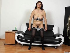 Are you a fan of sexy cougars? A Czech lady in her 50's feels comfortable, undressing in front of the camera... Click to watch this horny mature lady wearing stockings and high heels, removing her kinky bra and exposing her saggy boobs. It's dildo time!