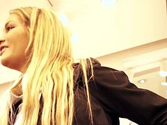 Long haired charming blonde Sunshine in smart office suit strips down to her white underwear before changing clothes. She unbuttons her blouse on camera in a fitting room.
