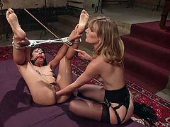Mona is a merciless mistress, who doesn't pay attention to Vivi Marie's moans. She has made the slutty brunette lesbian wear a kinky ball gag and has bonded her strongly. See the blonde bitch using a kinky vibrator, to produce orgasmic pleasures...