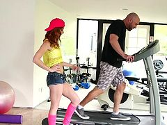A naughty teen gets carried away by her lusty fantasies and seduces the hot instructor from the gym. See the sexy redhead bitch undressing and sucking his cock on knees!