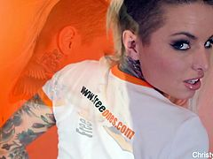Christy Mack teases the camera in her cute outfit