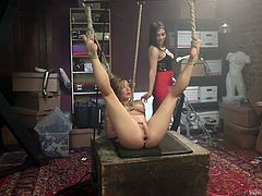 brunette mistress whipping her hot partner