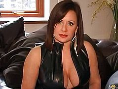Brunette sitting on a leather couch
