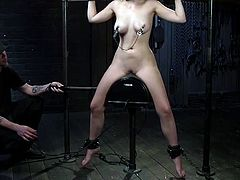Jenna has been a very bad girl. She's restrained by manacles and even has one around her neck. Her legs are shackled as well, making it impossible for her to move. She even has nipple clamps on and her executor is giving her some shocks, causing her a mixture of pain and pleasure. Subscribe to see!