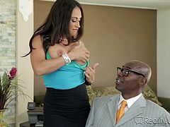 Sexy Claudia has an inciting way to greet guests. Click to watch the busty milf undressing and offering a welcome blowjob to a horny ebony guy. See the brunette slutty lady on high heels, sucking dick and spreading legs on the desk.