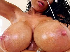 She gets her massive boobs covered in oil and lets him stick his throbbing member in between those mammaries. The hot slut deepthroats his cock and sucks on his swollen balls. She can fit it all in her mouth.