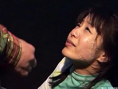 This cute Japanese babe thinks cum tastes disgusting, but there is nothing she can do about that, because she is on her knees. The men jack off and shoot their spunk all over her pretty face, tits and into her mouth.