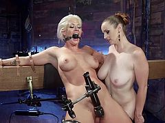 Slutty Bella Rossi enjoys dominating a helpless naked milf. The blonde bitch has been tied up and wears a kinky ball gag. Click to see the naughty mistress, using an electric vibrator to arouse her, while fingering her juicy pussy in the same time.
