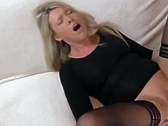 Beautiful German blonde in stockings fucked