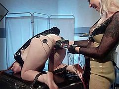 Lorelei is a naughty milf, who enjoys playing dirty with her redhead slave. Now, the merciless milf has bonded slutty Barbary, and attached numerous electrodes on her lovely buttocks. Click to watch the blonde bitch using a kinky dildo, to spice up the atmosphere.