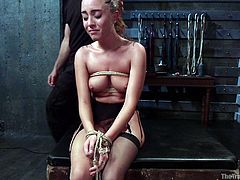 A tattooed slutty babe got strongly bonded with rope. The blonde cannot run away and has to please a horny executor. Watch the insanely hardcore scenes of anal sex and enjoy the kinky details! Roxanne obediently spreads legs, while her eyes or mouth get covered with a scarf.