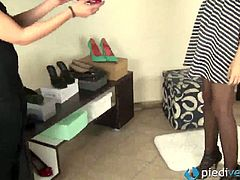 Tessa tries on different shoes on the feet of her girlfriend