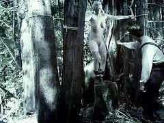 A perverse guy has found slutty Cherry and tied her in a strong creative rope bondage, in the woods. The naked babe with nice big boobs has also been gagged, so no one could hear her terrifying screams. Watch her cunt fingered with anger and lust!