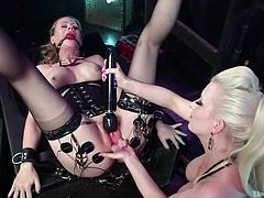 Cherry is a slutty milf's slave and now she has to be punished. Her mistress, Simone, has tied her hands and legs, and also attached kinky electrodes to her skin. The blonde helpless babe wears a ball gag, otherwise she might cry, when her pussy is awfully aroused with a vibrator and a dildo. Enjoy!