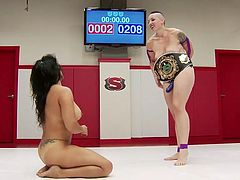 These hot naked lesbians are eager to fight in the wrestling arena, until they earn the supremacy... If you're wndering who's gonna be the winner, dare to watch Mistress Kara, dominating her brunette rival. See the mowhawk lady wearing a kinky strap on, while naughty Izamar waits obediently on her knees...