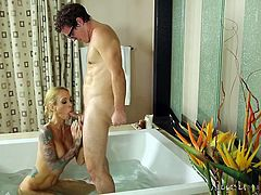 Slutty Sarah has many talents and mastering the art of erotic massages, is only of them. The sensual blonde milf looks extremely hot, when wearing nothing else on her, than her wonderful tattooes inked on her crazy body. See the busty lady sucking cock and getting in the bath tub with a horny guy.